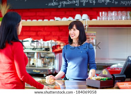 waitress serves customer in coffee shop