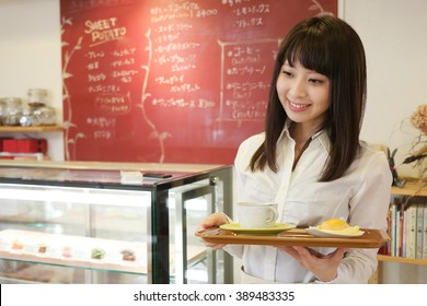 Waitress serving a cup of coffee and snacks