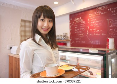 waitress serving a cup of coffee and sweet potato