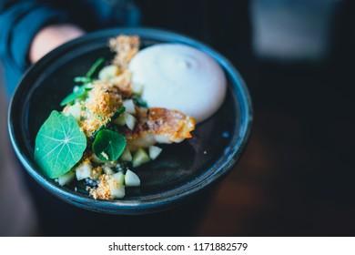 Waitress serving gourmet food