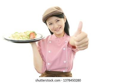 A waitress serving a meal.