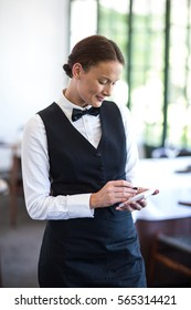 Waitress taking an order in a fancy restaurant