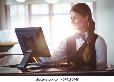 Waitress using a touchscreen in a restaurant