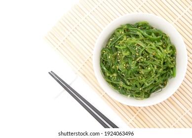 Wakame seaweed salad with sesame dressing. Traditional japanese food