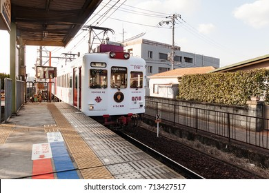 WAKAYAMA JAPAN - December 31: The strawberry electric train after departure form Kishi station on December 31, 2015 in Wakayama, Japan