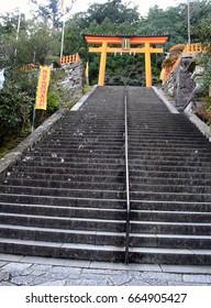 WAKAYAMA, JAPAN - DECEMBER 9, 2016: The Torii at the top of the stairs leading to Kumano Nachi Taisha Grand Shrine in Nachikatsuura, Wakayama, Japan.