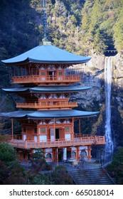 WAKAYAMA, JAPAN - DECEMBER 9, 2016: The pagoda of Seigantoji and Nachi no Taki waterfall in Nachikatsuura, Wakayama, Japan.