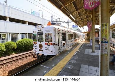"WAKAYAMA, JAPAN - MAR 26, 2019: The old vintage train named ""Tama Train"" that decorated like a white cat, running to Wakayama station."
