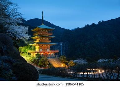 Wakayama, Japan - March 30, 2019: Kumano Nachi Taisha Shrine in Kumano Kodo pilgrimage routes with Nachi Falls, the tallest waterfalls in Japan in sakura or cherry blossom season
