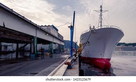 Wakayama, Japan, - May 16, 2018 : fishing boat are docked at Katsuura fish market in the morning To unload the fish from the boat, Nachikatsuura, Wakayama, Japan