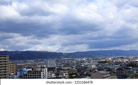 WAKAYAMA, JAPAN - NOV 2018:  Cityscape panorama skyline with beautiful blue sky on CBD of Wakayama Japan, view from city center building