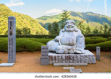 WAKAYAMA, JAPAN - NOVEMBER 19, 2015: Smile Kensenen Buddha, believed to be the symbol of wealth, located in Seiganto-ji temple