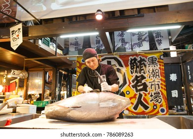Wakayama, JAPAN - NOVEMBER 29, 2017: Chef cutting tuna show traveler at Kuroshio Market is located on the west side of Porto Europa within Wakayama Marina City