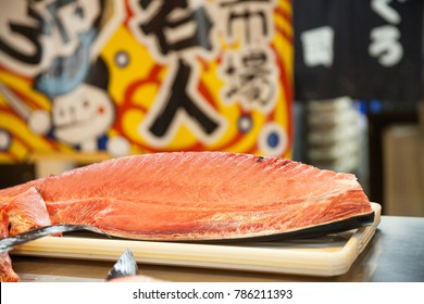 Wakayama, JAPAN - NOVEMBER 29, 2017: cutting of otoro from blue fin tuna for sashimi on stand at at Kuroshio Market is located on the west side of Porto Europa within Wakayama Marina City