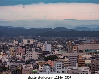Wakayama, Japan - October 10,2018 : View from Wakayama Castle in Rainy day, cloudy, fog at mountain. Evening time.