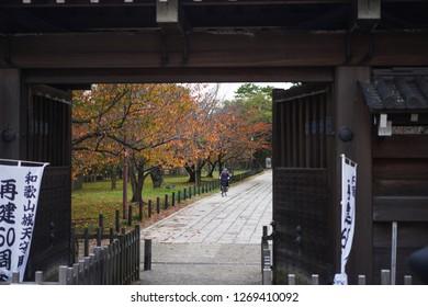 Wakayama - Nov. 17,2018: Japanese is seen riding bicycle in front of Wakayama Castle
