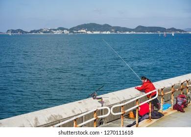 Wakayama - Nov. 17,2018: Japanese is seen fishing at Marina City, Wakayama