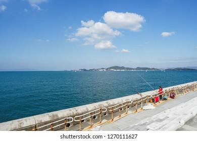Wakayama - Nov. 17,2018: Japanese are seen fishing at Marina City, Wakayama