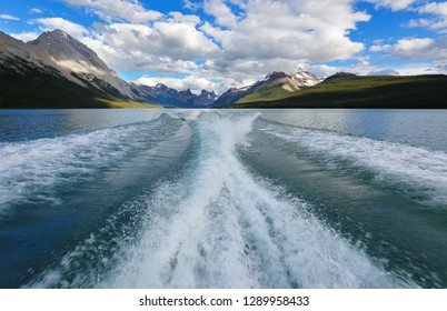 Wake behind a tourist boat on the Maligne Lake. Maligne Lake is a lake in Jasper National Park, Alberta, Canada.