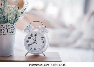 Wake up concept. Close up view of alarm-clock in morning