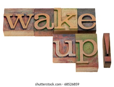 wake up - exclamation phrase in vintage wooden letterpress printing blocks, stained by color inks, isolated on white