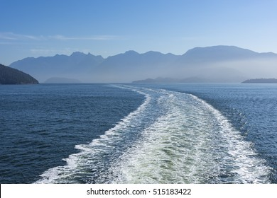 Wake of a Ferry near Vancouver Island with mountains in the background
