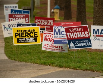 Wake Forest, NC/United States- 03/03/2020: A cluster of campaign signs are seen at a voting location in Wake Forest on Super Tuesday