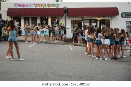 Wake Forest, NC/United States- 08/09/2019: Groups of teenage girls gather to socialize during an event downtown.