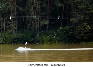Wakeboard. Cable wakeboarding is extreme sport. The movement of a man on the water occurs with the help of a mechanized cable-towing installation. Active lifestyle