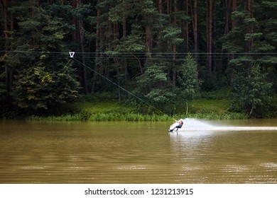 Wakeboard. Cable wakeboarding is extreme water sport. The movement of a man on the water occurs with the help of a mechanized cable-towing installation. Active lifestyle
