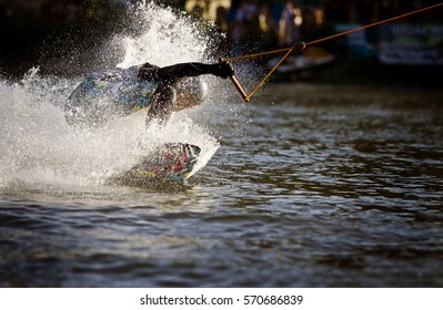 Wakeboard in water. A man is riding a wakeboard