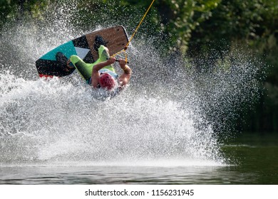 Wakeboarder make a trick on a lake