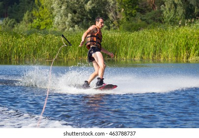 Wakeboarder making tricks. Action time in summer