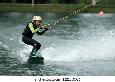 Wakeboarder Practice to prepare for the World Championships. At Wakeboarding School in Pathumthani, Thailand on October 07, 2018.
