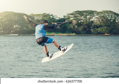wakeboarder trains in the lake