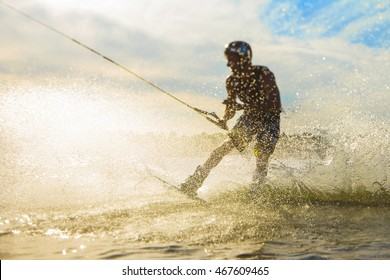 wakeboarder trains at sunset