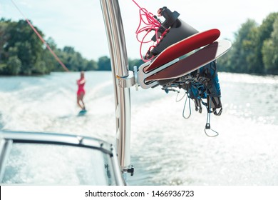 Wakeboarding equipment. Woman wakeboarder in the distance in bright sportswear following a yacht with the additional wakeboarding equipment