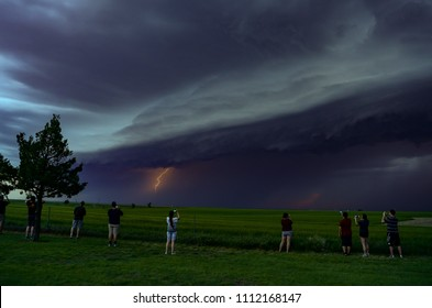 Wakeeney, Kansas / United States - May 24, 2018:  Lightning Bolts from an approaching Severe Thunderstorm or MCS in the Central Plains during a convective field study.