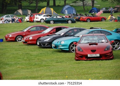 WAKEFIELD, ENGLAND - MAY 10: Red Toyota Celica with Row of Cars on Display at the Annual Rising Sun Car Show on May 10, 2008 in Wakefield, England, UK.  Norton Priory is host to the show