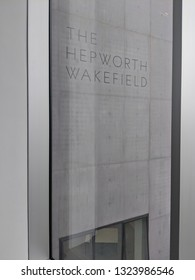 WAKEFIELD, ENGLAND - SEPTEMBER 2, 2018: Closeup of sign engraved in the concrete wall of Hepworth Gallery in Wakefield, Yorkshire, UK, named for the sculptor Barbara Hepworth who was born in the town