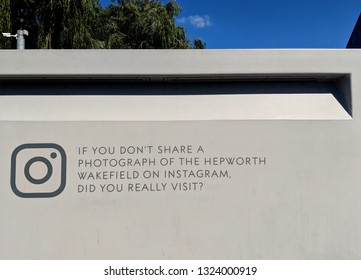 WAKEFIELD, ENGLAND - SEPTEMBER 2, 2018: Sign exhorting visitors to post photographs on Instagram, etched in concrete at Hepworth Gallery in Wakefield, Yorkshire, UK