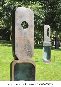 WAKEFIELD, UK - AUGUST 6, 2016. Two of The Family of Man bronze sculptures by Barbara Hepworth, exhibiting at the Yorkshire Sculpture Park, near Wakefield, west Yorkshire, UK.