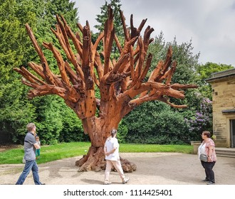 WAKEFIELD, UK - JUNE 10, 2018. Iron Tree is a sculpture by Al Weiwei, exhibiting at the Yorkshire Sculpture Park, near Wakefield, West Yorkshire, UK.