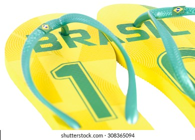 WAKEFIELD, UK - MARCH 4, 2014 - Havaianas World Cup Edition - Brasil. Popular Brazilian flip-flop brand made by Alpargatas. Isolated on a white background.