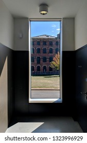 WAKEFIELD, UK - SEPTEMBER 2, 2018: Contrasting view of Victorian Grade II listed Rutland Mill through a window at Modernist Hepworth Gallery in Wakefield, Yorkshire, UK