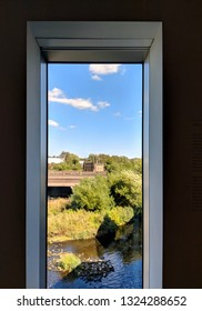 WAKEFIELD, UK - SEPTEMBER 2, 2018: View of the river and weir outside through a window at Hepworth Gallery in Wakefield, Yorkshire, UK