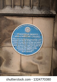 WAKEFIELD, UK - SEPTEMBER 2, 2018: Blue Plaque of 13th century, Grade I listed Chantry Chapel of St Mary the Virgin, rising from the river as part of Wakefield Bridge, Yorkshire, UK