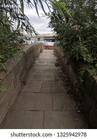 WAKEFIELD, UK - SEPTEMBER 2, 2018: Grade II listed narrow 18th century pack-horse bridge, Wakefield, Yorkshire, UK