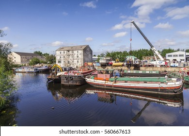 Wakefield, West Yorkshire, England: 2 June 2011 - River and Canal boats on the River Calder at Wakefield Waterfront, West Yorkshire, England, two have been hauled from the water.