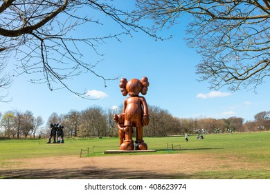WAKEFIELD, YORKSHIRE, UK - APRIL 19TH 2016: Sculptures by the renowned American artist KAWS exhibited at the Yorkshire Sculpture Park.